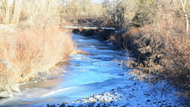 The West Walker River in Wellington, covered in ice and snow with the bridge leading to the Compston home in the distance, as seen early this month.