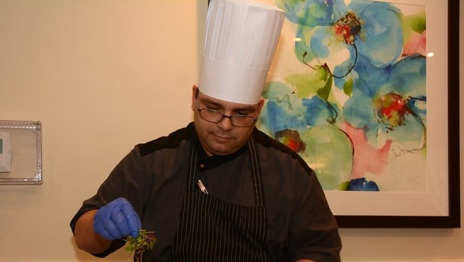 Executive chef Marlon Perez prepares a lunch of sea scallops and braised oxtail. The Carlisle Naples held a cooking demonstration and luncheon on Thursday, Sept. 29, focusing on meals for older eaters and showcasing the culinary offerings of the North Naples retirement community.