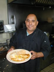 "Francisco ""Pancho"" Espindola, cook and manager, holds"