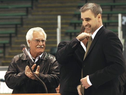 Tom Anastos (R) was named the new hockey coach of