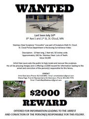 A poster offering a reward for information regarding the stolen statue released by Police
