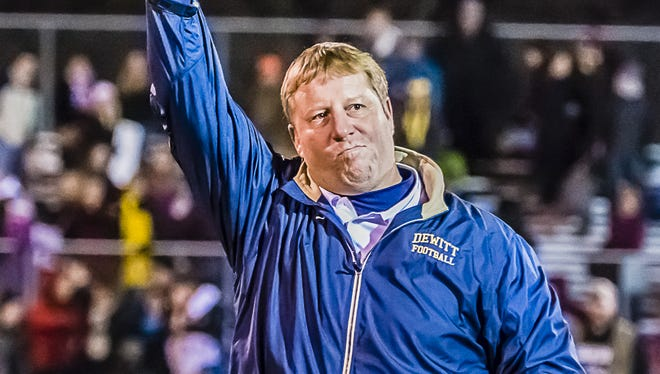 DeWitt coach Rob Zimmerman hoists the Division 3 regional championship trophy after the Panthers' win over Eaton Rapids last fall.  LSJ file DeWitt Football Head Coach Rob Zimmerman hoists the Division 3 regional final championship trophy after the Panthers win over Eaton Rapids Friday November 15, 2013 in DeWitt.  KEVIN W. FOWLER PHOTO