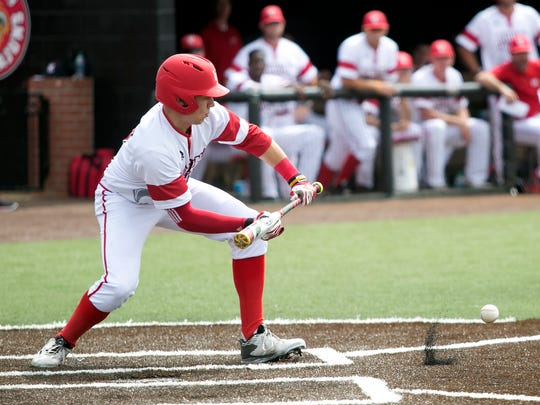 UL shortstop Brad Antchak puts down a key bunt that moved Dylon Poncho to third base in the Cajuns' 4-1 win over Georgia State on Saturday at The Tigue.