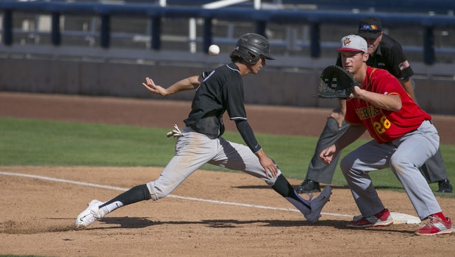 Hamilton's Drew Swift (2) runs safely back to first before a tag can be applied by Chaparral's Jacob Gonzalez (26)  during the State Baseball Tournament at Maryvale Baseball Park on May 5, 2016 in Phoenix, Ariz.