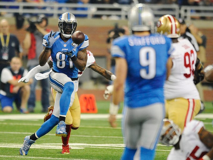 Calvin Johnson makes a reception in the first quarter