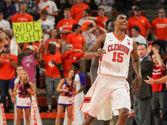 Clemson forward Donte Grantham (15) reacts after North