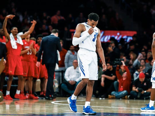 Dejected Memphis guard Jeremiah Martin (middle) wipes his face during the final seconds of a 81-72 loss to Louisville at Madison Square Garden in New York, Saturday, December 16, 2017.