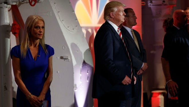 Donald Trump stands with his campaign manager, Kellyanne Conway, left, prior to the Commander in Chief Forum hosted by NBC News on Sept. 7, 2016, in New York.