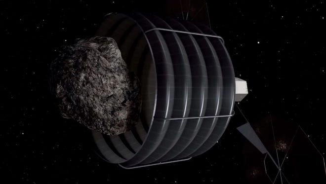 A still frame from a NASA animation showing how the proposed asteroid-capturing mission would work.