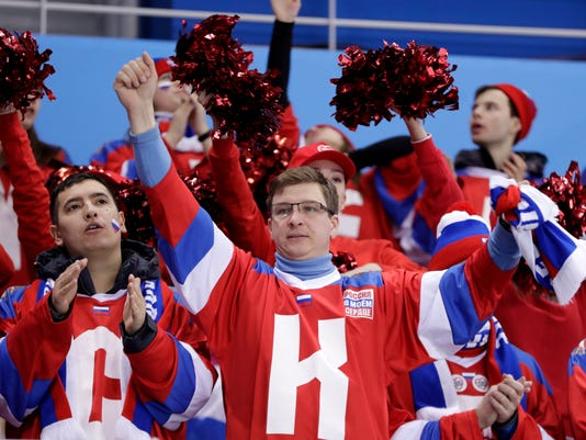 Fans of the Olympic Athletes from Russia cheer during the second period of a preliminary round women's hockey game against Finland at the 2018 Winter Olympics in Gangneung, South Korea, Thursday, Feb. 15, 2018. (AP Photo/Julio Cortez)