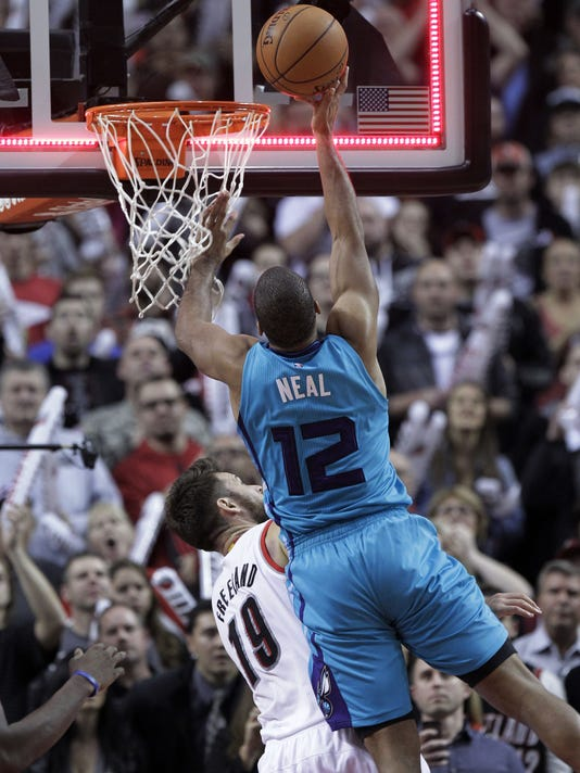 Charlotte Hornets guard Gary Neal, right, shoots against Portland Trail Blazers forward Joel Freeland, from England, just as the buzzer goes off to the second half of an NBA basketball game in Portland, Ore., Tuesday, Nov. 11, 2014.  The play was reviewed and ruled no basket, giving the Trail Blazers a 102-100 victory. (AP Photo/Don Ryan)