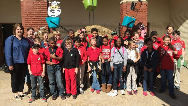 Carolyn Lang (left) stands outside of AgMagic at The Louisiana State Fair in Shreveport with her 4-H group.