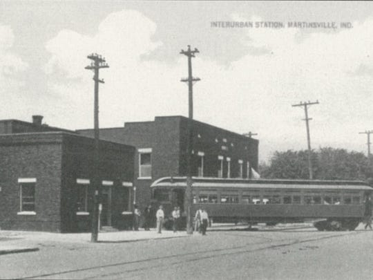The Martinsville Interurban station in 1915. The brick building at left is the ticket and wait station on North Main St.  and the Eslinger Hotel is behind the car.