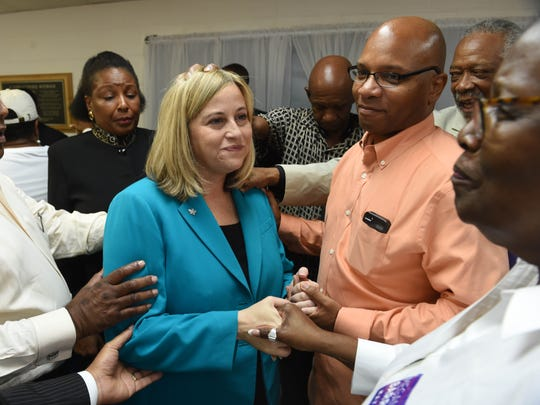 Local ministers and leaders pray and lay hands on mayoral candidate Megan Barry during a  prayer breakfast at Jefferson Street Baptist Church on Monday.