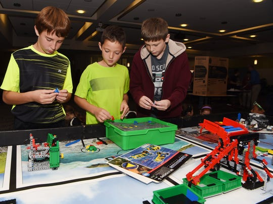 Students from Brinckerhoff Elementary School put together a LEGO model as part of GlobalFoundries' celebration of National Manufacturing Day. From left to right: Ethan Fogarty, 11; Scott Klosen, 11; Tyler Sammer, 11.