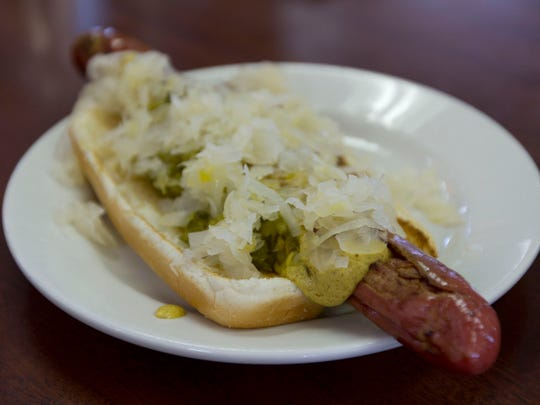 A crisp-skinned hot dog topped with mustard, relish and sauerkraut at Max's Famous Hot Dogs in Long Branch, which has been in business for 85 years.