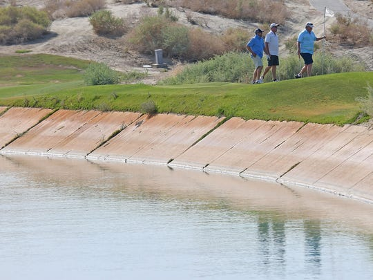 Golfers play at Terra Lago in Indio, one of just two Coachella Valley courses almost exclusively using Colorado River water, on June 1, 2015.