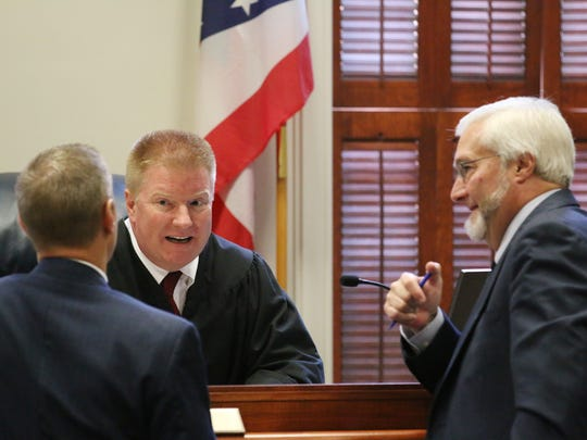 Judge Michael Ater (center), Prosecutor Matthew Schmidt (left) and defense attorney Gregory Meyers have a discussion during day two of Jason McCrary's murder trial.