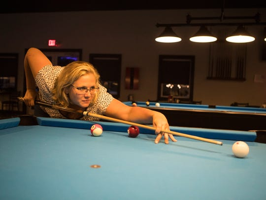 Emily Parker plays pool at the Slate Cafe in Smyrna on Monday, July 16, 2018. Parker and others will be traveling to Las Vegas for the American Poolplayers Association World Pool Championships at the Westgate Las Vegas Resort & Casino in August.