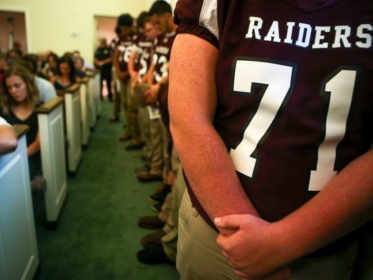 Spring Hill High School football players hold their