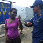 Lt. Lauren Shade talks with Marphen Yardolo, the ninth Ebola survivor treated at the clinic in Monrovia, Liberia, set up by the U.S. Public Health Service Commissioned Officer Corps.