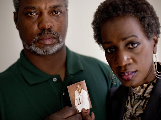 AP   Pam Champion, right, and Robert Champion Sr., left, hold a photo of their son, Robert, a Florida A&M University drum major who died in a hazing incident in 2011. They agreed to a $1.1 million settlement on Friday. FILE- In this May 23, 2012 file photo, Pam Champion, right, and Robert Champion, Sr., left, hold a photo of their son, Robert, a Florida A&M University drum major who died in a hazing incident, as they are photographed in their attorney's office following a press conference in Atlanta.  The trial for four band members charged in the hazing death of Champion begins Monday, Oct. 27, 2014 in Orlando, Fla.(AP Photo/David Goldman, File)
