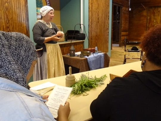 An instructor in historical costume provides a glimpse