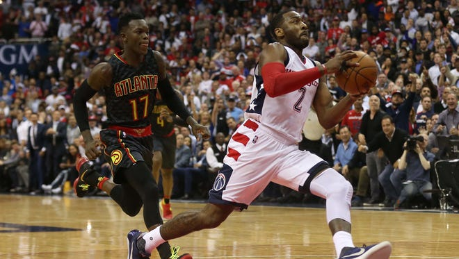 Washington Wizards guard John Wall (2) drives to the basket as Atlanta Hawks guard Dennis Schroder (17) chases in the fourth quarter in game two of the first round of the 2017 NBA Playoffs at Verizon Center.