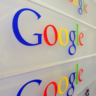 Google logo is seen on a wall at the entrance of the