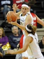 Rebekah Dahlman (1) grabs a rebound against Dayton last season.