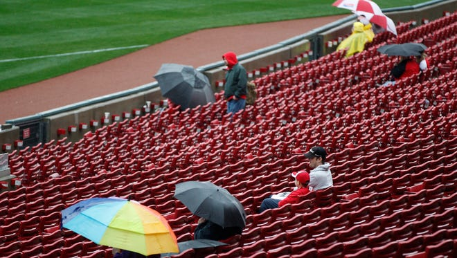 A few faithful Reds fans wait out a rain delay before the start of today's game at GABP.