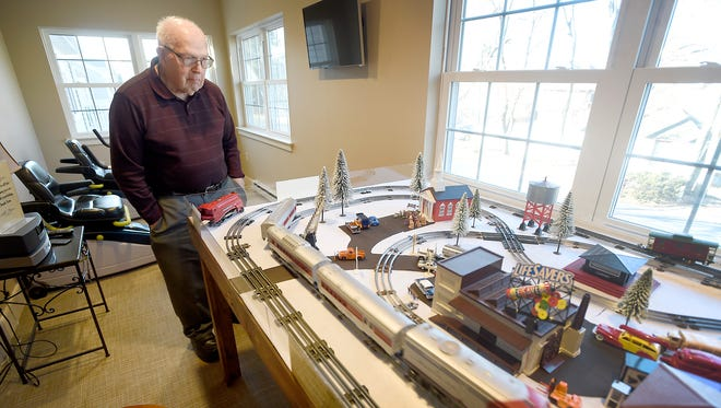Eighty-eight-year-old Harold Reist stands beside the train he, his sons, grandson, and great-grandson constructed for the residents at Kindred Place at Annville.