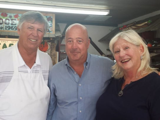 Andrew Zimmern of The Travel Channel, center, with