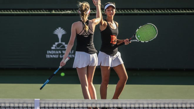 Palm Desert's Maddy Woodford, left, and Maeli Martin celebrate a point won during the DVL girls doubles finals on Tuesday, October 24, 2017 in Indian Wells.