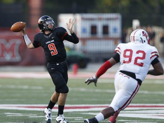 Loveland High School's Drew Plitt, 9, throws a touchdown pass over defender, Lakota West High School's Devin Pearson, 92.