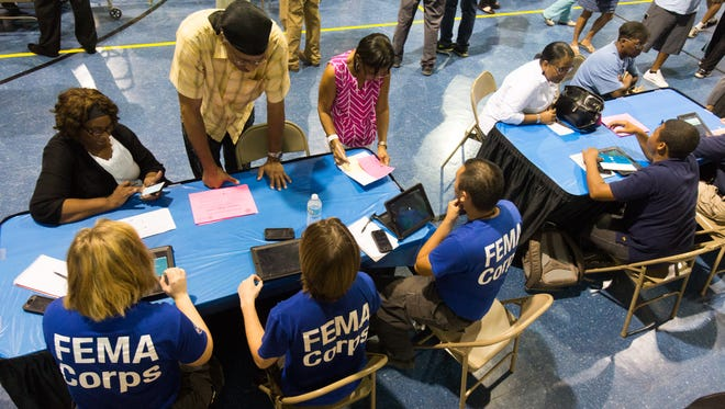Residents meet with FEMA representatives during a meeting to provide people from the Derby Heights subdivision information on how to get help with their flooded homes in Lafayette August 31, 2016.