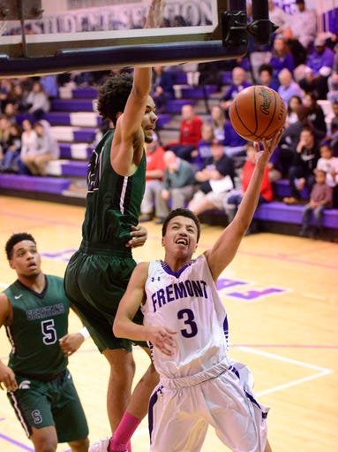 Fremont's Davion Anderson (3) shot is blocked by Start's