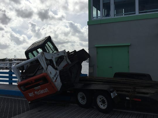 A crash closed both lanes of Dixie Highway on the old Roosevelt Bridge in Stuart on Tuesday.