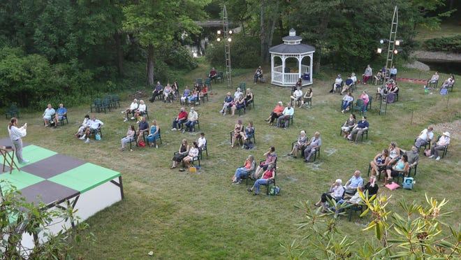 """A socially distanced group of 70 attend the Akron area's first live theater production since the coronavirus shutdown in March with opening night of Ohio Shakespeare Festival's """"The Complete Works of Shakespeare (Abridged) [revised]"""" Friday at Stan Hywet's lagoon."""