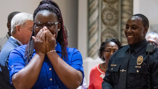 Montgomery Police Officer Nathaniel Parker, Jr., proposes to his girlfriend Jasmine Reed after getting his shield at the Montgomery Police Academy graduation for Class 2018-A at city hall in Montgomery, Ala, on Thursday July 11, 2018.