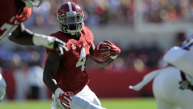 Alabama running back T.J. Yeldon (4) carries the ball for a first quarter touchdown against Texas A&M at Bryant-Denny Stadium in Tuscaloosa, Ala. on Saturday October 18, 2014.