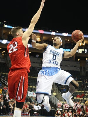 Rhode Island Rams guard E.C. Matthews (0) shoots against Davidson Wildcats forward Will Magarity (22) during the second half at the PPG Paints Arena. Rhode Island won 84-60.