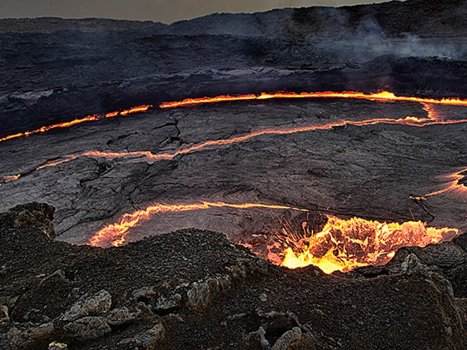 """The Danakil Depression, in  the northeastern corner of Ethiopia, has the distinction of being the hottest place on earth, with recorded temperatures of 125 degrees. It's sometimes called """"the gateway to Hell.""""  The lava lake in the Erta Ale volcano is one of only 4 living lava lakes in the world."""