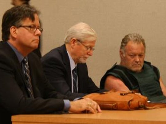 Dennis Turner, at far right, pled guilty to ten counts