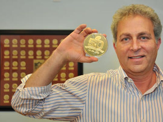 Michael Kott, president and CEO of The Highland Mint in Melbourne with the coin used for the coin flip for Super Bowl 50 between the Denver Broncos and the Carolina Panthers in 2016.  The Highland Mint has been making the Super Bowl flip coin for the last 25 years.
