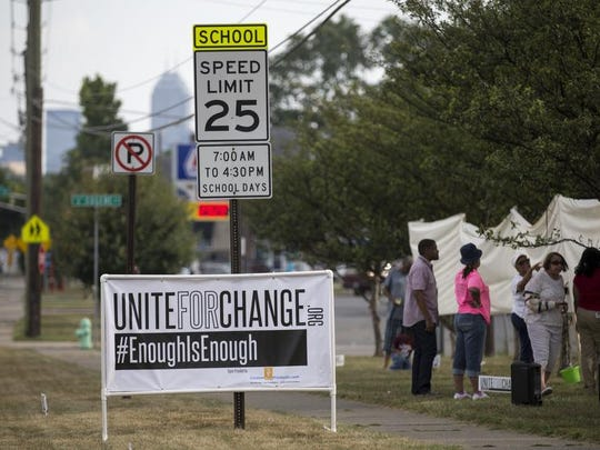 A sign in front of an effort by Pastor John Girton to raise awareness to city crime by camping in a tent for a month, corner of West 30th and Martin Luther King Jr. streets, Indianapolis, Friday, Sept. 4, 2015.