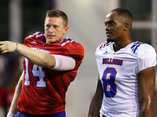 Louisiana Tech quarterback Ryan Higgins, left, talks with quarterback J'Mar Smith during an August 2016 scrimmage.