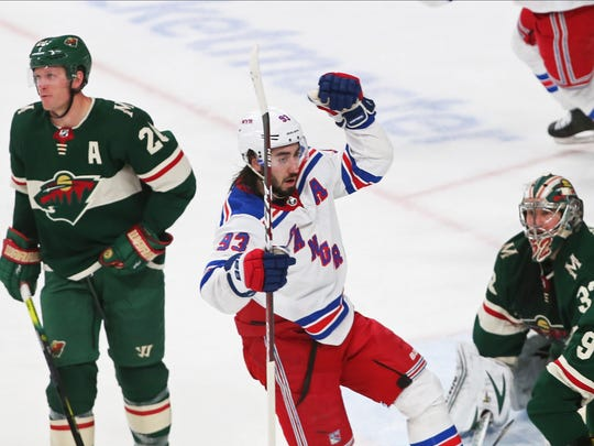 New York Rangers' Mika Zibanejad, center, celebrates his game-tying goal against Minnesota Wild's Alex Stalock, lower right, during the third period of an NHL hockey game Thursday, Feb. 13, 2020, in St. Paul, Minn. The Rangers won 4-3 in a shootout. (AP Photo/Jim Mone)