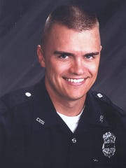 "Indianapolis Police Department officer Timothy ""Jake"" Laird was killed in line of duty Aug. 18, 2004."