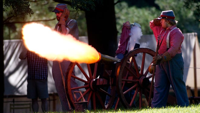 Rebel canonniers fire canister on approaching Union troops, during a Civil War re-enactment at Renfrew Museum Saturday.